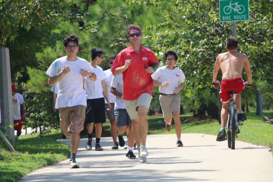 Seniors Daniel Griggs '19 and Diego Guajardo '19 jog down the sidewalk during Walk-a-thon. They were trying to get a little exercise in while also raising funds for the Student Council.
