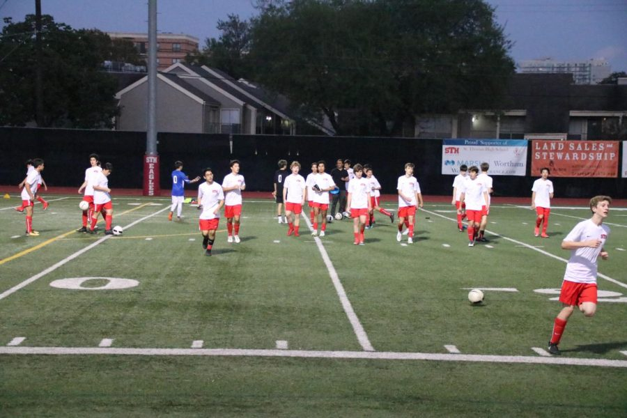 The JV squad just finished pregame warm ups and is ready to take it to the pitch for their home opener.