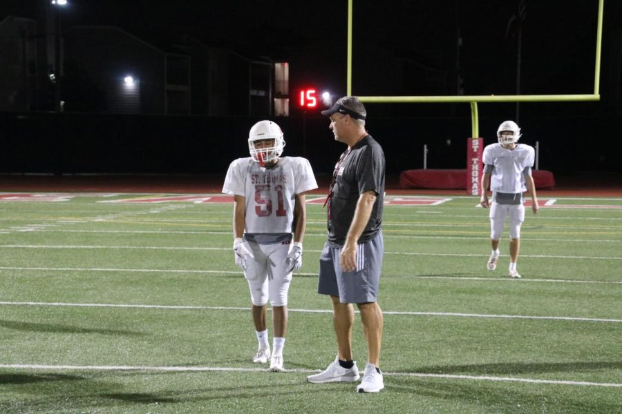 Part of practice is learning from your mistakes. Head coach Rich McGuire is very involved in his practice, pictured here correcting his middle linebacker Austin Castro '19.