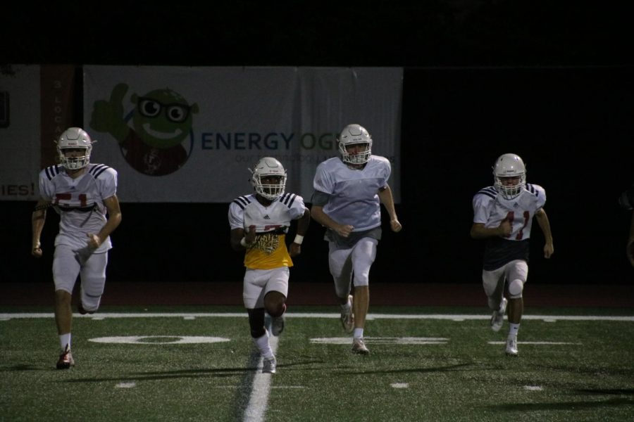 """Conditioning can often be neglected from a regular team's practice; however, Eagle football players do not shy away from this aspect, even when they are pushed to the very limit of their abilities. Just when you think practice is over, Coach McGuire yells """"sideline"""" and everybody competes, with Daniel Coco, Jamal Jenkins, and Josh Madden leading the charge."""