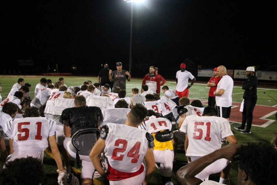 After the conclusion of conditioning, the entire team huddles to listen to Coach McGuire's comments on practice and note any new announcements for the week's agenda. Every practice is ended with a prayer of intentions and an Our-Father, with each team member holding hands, symbolizing their strong connection as a true family.