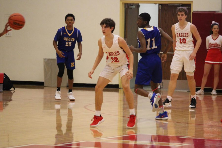 Dillon Lowe '21 stays on his toes as he locks up his defender.