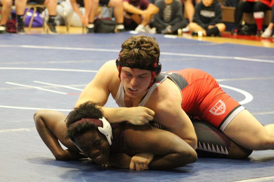 Jackson Phillips works to dominate his opponent in the Clear Lake Dual.