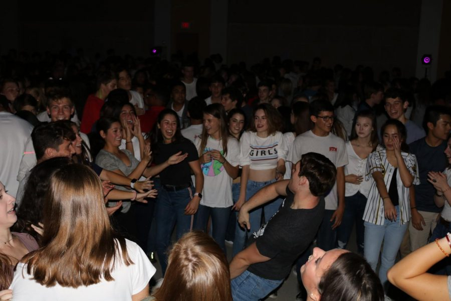 """Jackson Phillips 20' impresses the formed crowd around him with his expert dancing capabilities.  """"I had a very good time, I was happy to see that it was open to students of all grades this year because it gave me an awesome opportunity to meet new people"""" Phillips says."""