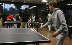 Bryce Tilotta '22 playing a fierce game of ping pong against a fellow classmate.