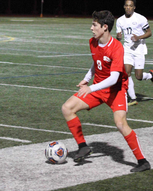 Alex Rivero '20 moves the ball forward in a late season game against St. Pius X.